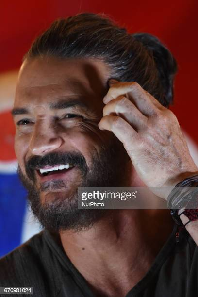 Singer Ricardo Arjona is seen touching the forehead during a press conference to promote the latest album 'Circo Soledad' at Estacion Indianilla on...