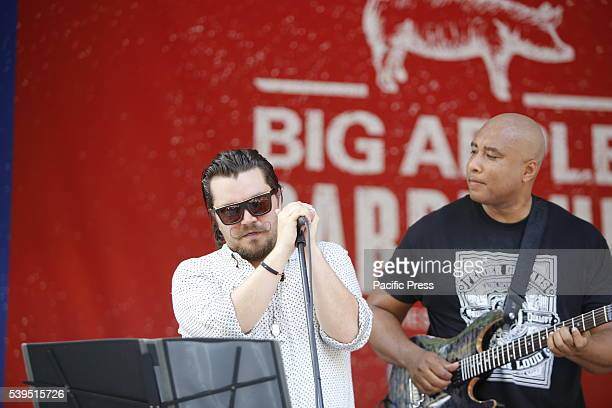 Singer Richie Cannata with guitarist Bernie Williams of the Bernie Williams Official perform The annual Madison Square BBQ festival brought smoked...