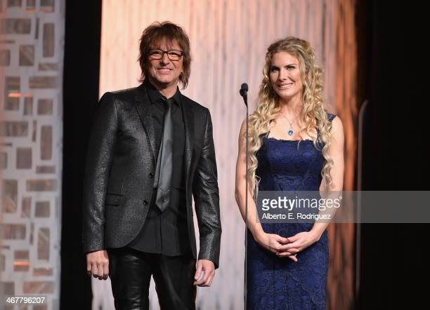 Singer Richie Sambora and actress Kelly Greyson speak on stage at the 22nd Annual Movieguide Awards Gala at the Universal Hilton Hotel on February 7...