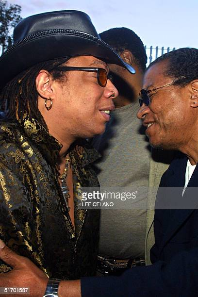 """Singer Rick James and US actor Billy Dee Williams embrace as they arrive for the premiere of US director Spike Lee's documentary feature """"Jim Brown:..."""