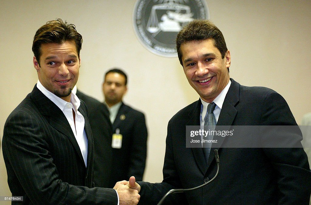 Ricky martin and former manager drop lawsuits photos and images singer ricky martin l and his former manager angelo medina r shake m4hsunfo