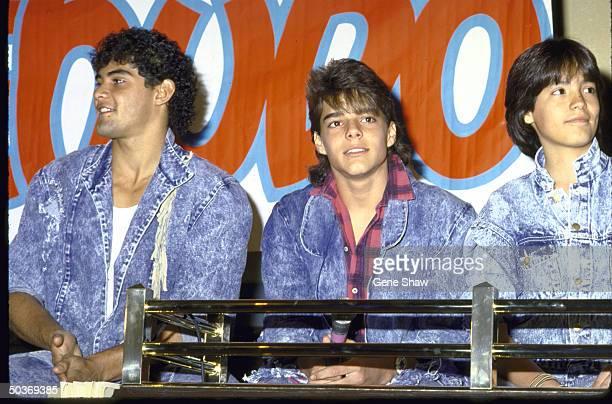Singer Ricky Martin and Menudo band members