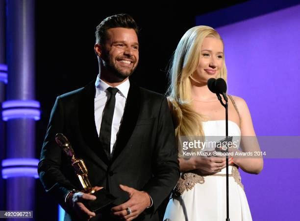 Singer Ricky Martin and rapper Iggy Azalea speak onstage during the 2014 Billboard Music Awards at the MGM Grand Garden Arena on May 18 2014 in Las...