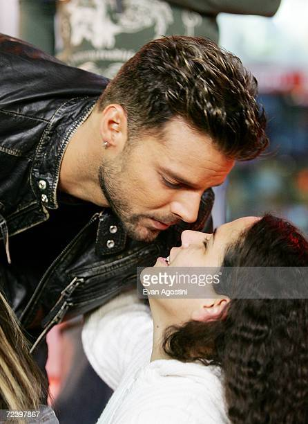 Singer Ricky Martin kisses a fan during his appearance on MTV3 MI Total Request Live at MTV Studios November 03 2006 in New York City