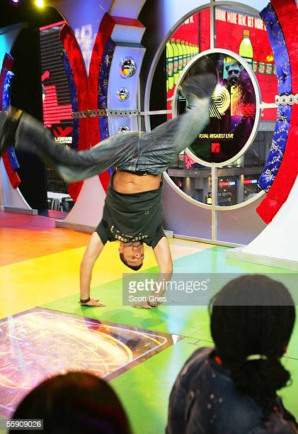 Singer Ricky Martin practices the musical/dance martial artform capoeira onstage during MTV's Total Request Live at the MTV Times Square Studios on...