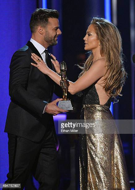 Singer Ricky Martin presents the Icon Award to singer/actress Jennifer Lopez during the 2014 Billboard Music Awards at the MGM Grand Garden Arena on...