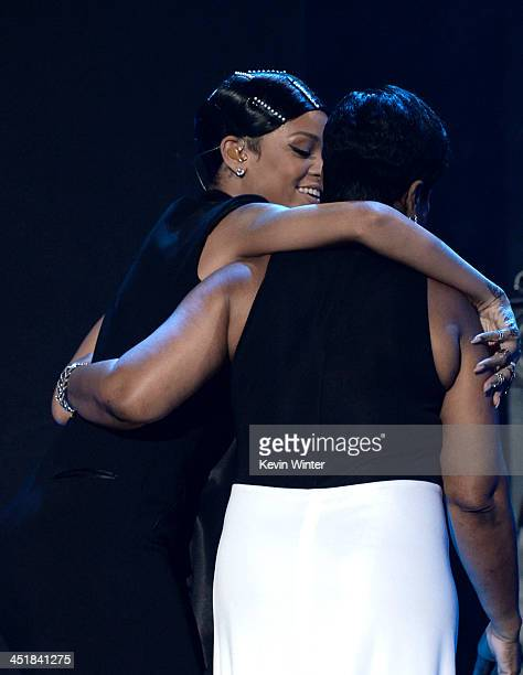 Singer Rihanna accepts the AMA Icon Award from her mother Monica Braithwaite onstage during the 2013 American Music Awards at Nokia Theatre LA Live...