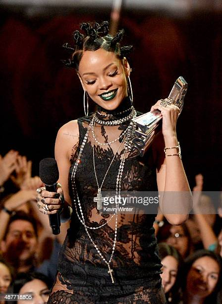 Singer Rihanna accepts the Artist of the Year award onstage during the 2014 iHeartRadio Music Awards held at The Shrine Auditorium on May 1, 2014 in...