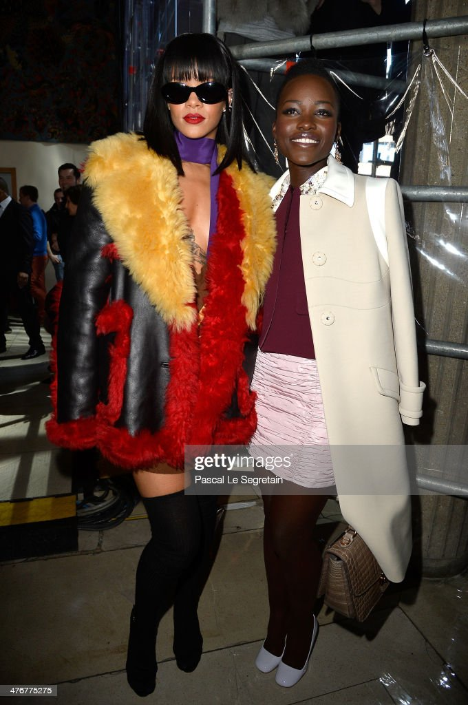 Singer Rihanna and actress Lupita Nyong'o attend the Miu Miu show as part of the Paris Fashion Week Womenswear Fall/Winter 2014-2015 on March 5, 2014 in Paris, France.