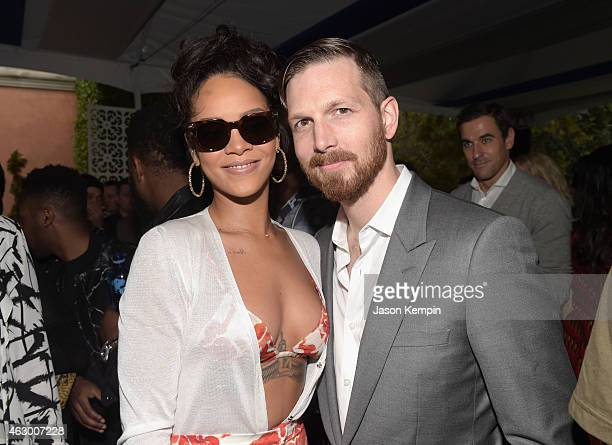 Singer Rihanna and Adam Petrick Global Brand Marketing Director for PUMA attend Roc Nation and Three Six Zero PreGRAMMY Brunch 2015 at Private...
