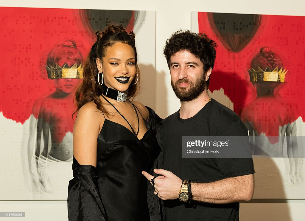 Singer Rihanna (L) and artist Roy Nachum at Rihanna's 8th album artwork reveal for 'ANTI' at MAMA Gallery on October 7, 2015 in Los Angeles, California.