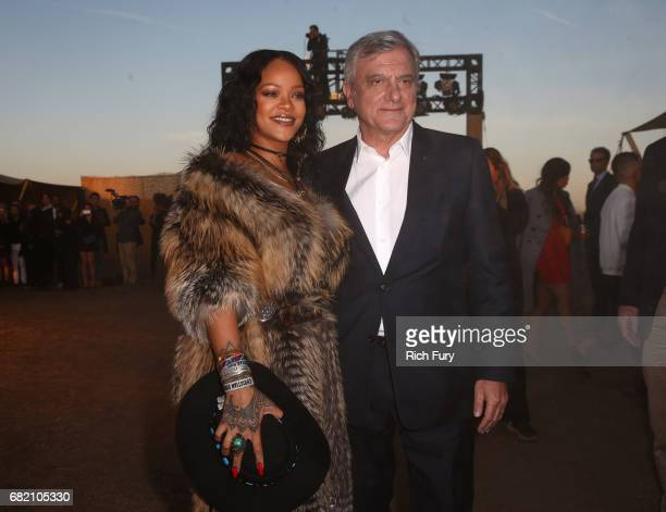 Singer Rihanna and Christian Dior Couture president and CEO Sidney Toledano attends the Christian Dior Cruise 2018 Runway Show at the Upper Las...