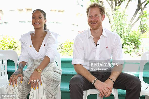 Singer Rihanna and Prince Harry speak on stage at the 'Man Aware' event held by the Barbados National HIV/AIDS Commission on the eleventh day of an...