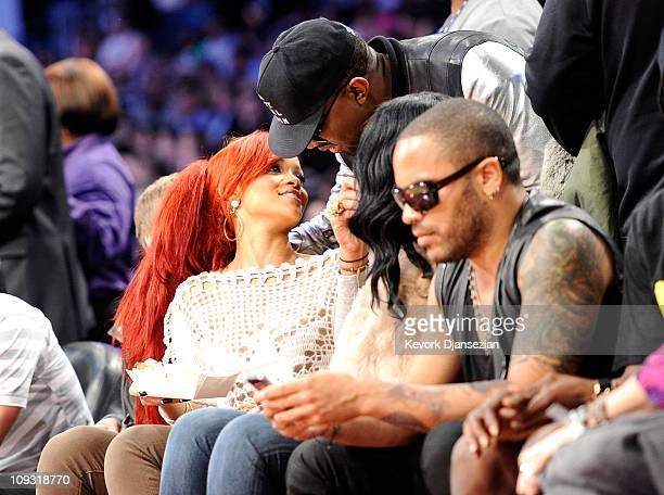 Singer Rihanna and rapper Kanye West greet each other in the audience during the 2011 NBA AllStar game at Staples Center on February 20 2011 in Los...