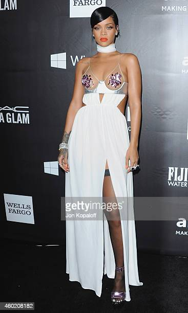 Singer Rihanna arrives at the 2014 amfAR LA Inspiration Gala at Milk Studios on October 29 2014 in Hollywood California