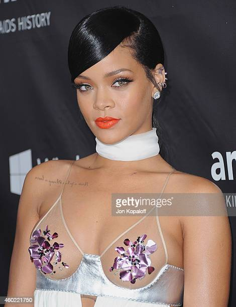 Singer Rihanna arrives at the 2014 amfAR LA Inspiration Gala at Milk Studios on October 29, 2014 in Hollywood, California.