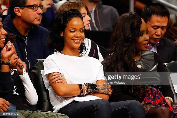 Singer Rihanna attends an NBA game between the Brooklyn Nets and the Miami Heat at Barclays Center on January 10 2014 in the Brooklyn borough of New...