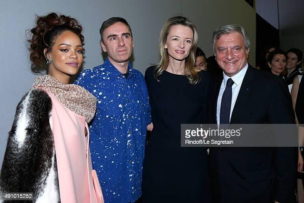Singer Rihanna Fashion Designer Raf Simons Louis Vuitton's executive vice president Delphine Arnault and CEO Dior Sidney Toledano pose Backstage...