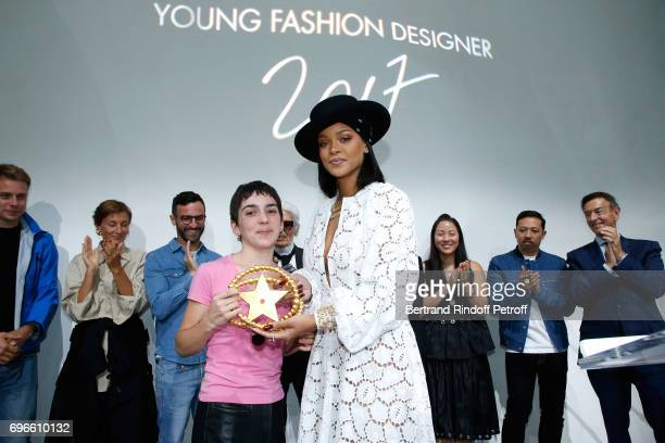 Singer Rihanna gives the price to the Winner of the 'Young Fashion Designer' LVMH Prize 2017 Stylist Marine Serre during the 'Young Fashion Designer'...