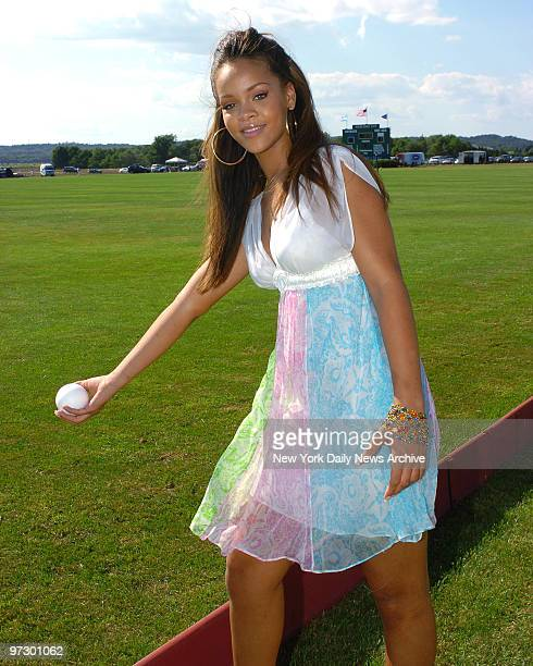 Singer Rihanna of Barbados prepares to toss out the first ball as she hosts the annual MercedesBenz Polo Challenge at the Bridgehampton Polo Club in...