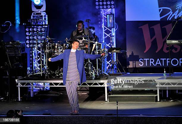 Singer Rihanna performs after switching on the Christmas lights at Westfield Stratford City with young ambassadors from Save The Children Westfield's...