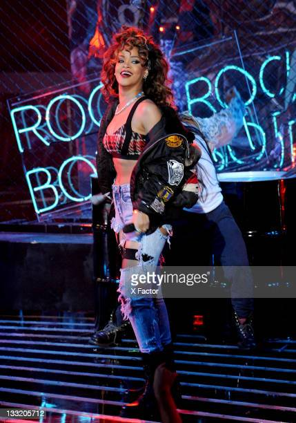 """Singer Rihanna performs onstage at FOX's """"The X Factor"""" Top 10 to 9 Live Elimination Show on November 17, 2011 in West Hollywood, California."""