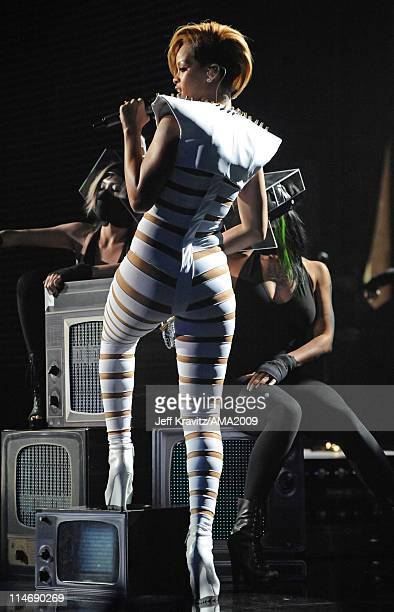 Singer Rihanna performs onstage at the 2009 American Music Awards at Nokia Theatre LA Live on November 22 2009 in Los Angeles California