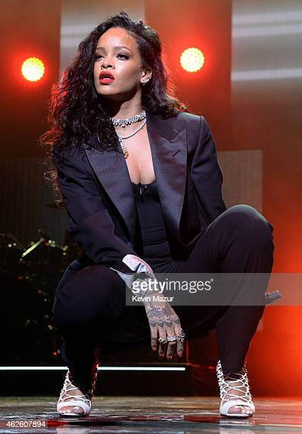 Singer Rihanna performs onstage during DirecTV Super Saturday Night hosted by Mark Cuban's AXS TV and Pro Football Hall of Famer Michael Strahan at...