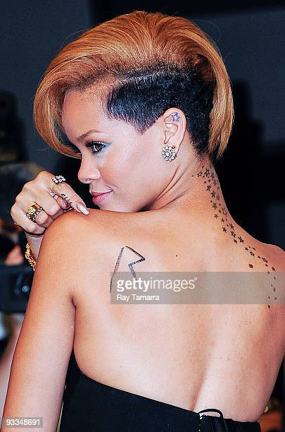 Singer Rihanna poses for photos at Best Buy on November 23 2009 in New York City