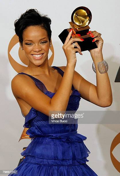 Singer Rihanna poses with the Best Rap/Sung Collaberation award in the press room during the 50th annual Grammy awards held at the Staples Center on...