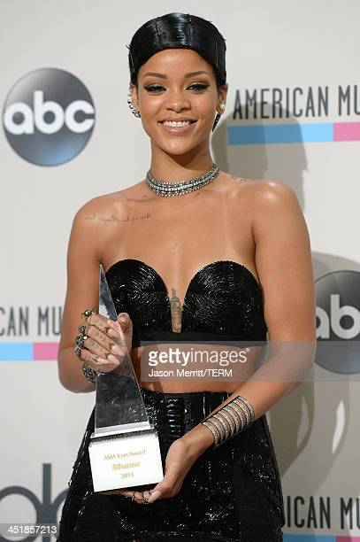Singer Rihanna poses with the Icon Award in the press room during the 2013 American Music Awards at Nokia Theatre LA Live on November 24 2013 in Los...