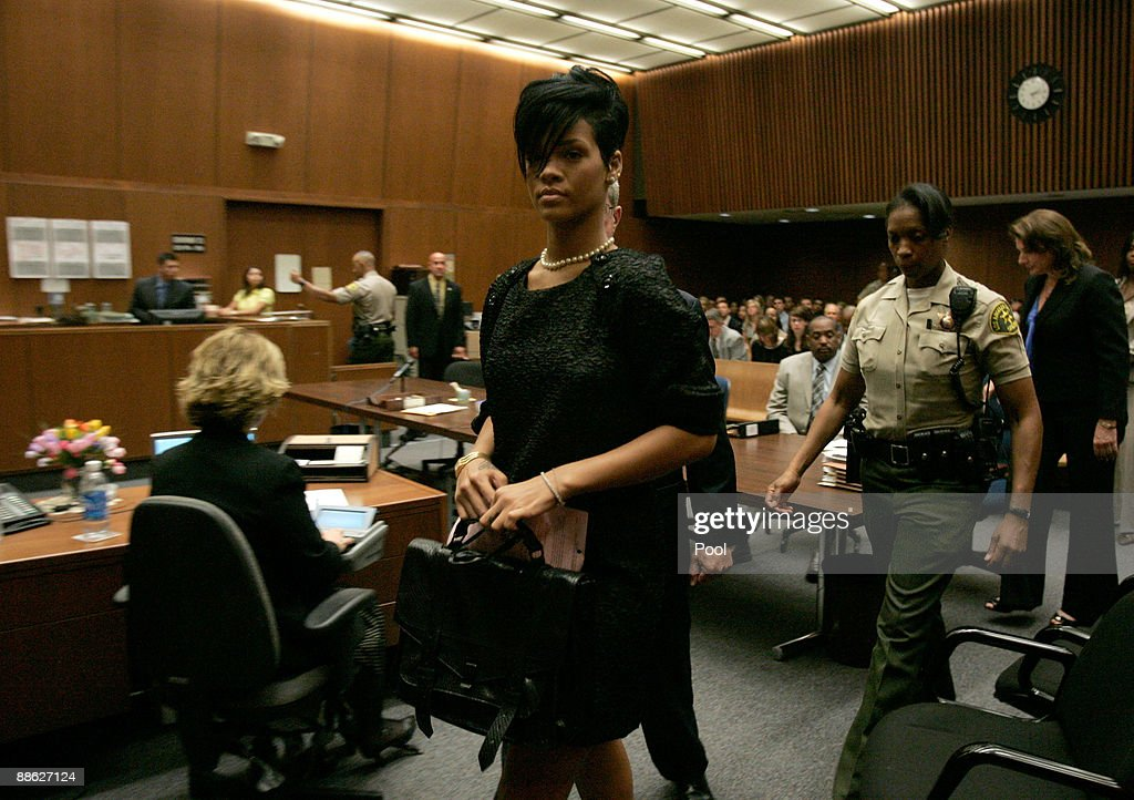 Singer Rihanna (C) walk out of a preliminary hearing at Superior Court of Los Angeles County on June 23, 2009 in Los Angeles, California. The preliminary hearing is to determine if Chris Brown will stand trial for allegedly attacking pop singer Rihanna, during an argument in a rented Lamborghini sports car following a pre-Grammy Awards party on February 8, 2009. He is currently free on $50,000 bail.