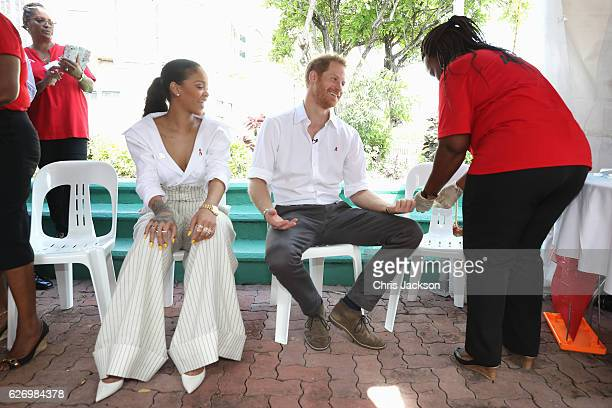 Singer Rihanna watches as Prince Harry gets his blood sample taken for an live HIV test in order to promote more widespread testing for the public at...