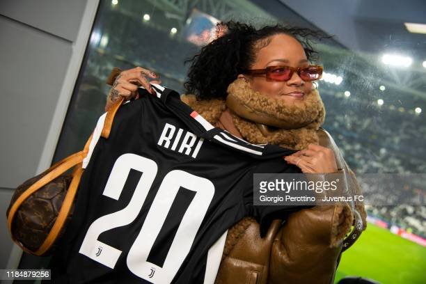 Singer Rihanna with Juventus' t-shirt attends the UEFA Champions League group D match between Juventus and Atletico Madrid at Allianz Stadium on...