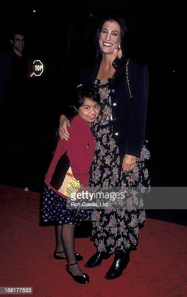 Singer Rita Coolidge and goddaughter attend the release party for 'Cinderella' on October 2 1995 at Walt Disney Studios in Burbank California