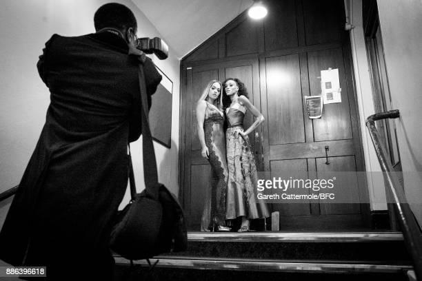 Singer Rita Ora and model Winnie Harlow pose backstage during The Fashion Awards 2017 in partnership with Swarovski at Royal Albert Hall on December...