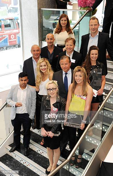 Singer Rita Ora and Sir Philip Green pose with sponsors Christos Angelides Karren Brady Sir Charles Dunstone Jason Tarry and Marc Bolland and winners...