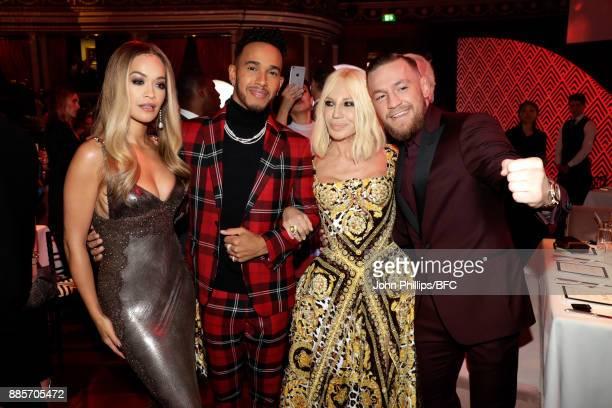 Singer Rita Ora F1 Driver Lewis Hamilton designer Donatella Versace and MMA Fighter Connor McGregor are seen at The Fashion Awards 2017 in...