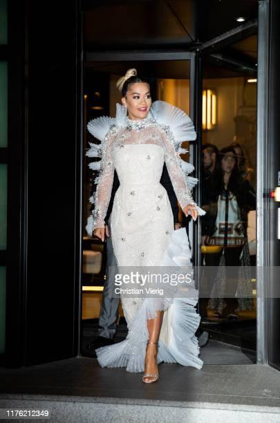 Singer Rita Ora is seen wearing white sheer dress on the way to Amfar seen during the Milan Fashion Week Spring/Summer 2020 on September 21 2019 in...