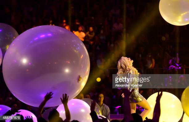 Singer Rita Ora performs during the final of Germanys Next Top Model TV show at Lanxess Arena on May 8 2014 in Cologne Germany The three finalists...