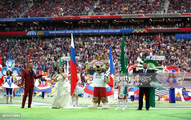 Singer Robbie Williams and Russian Soprano Aida Garifullina and Ronaldo react after their performance in the opening ceremony prior to the 2018 FIFA...