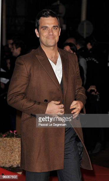 Singer Robbie Williams arrives at Palais des Festivals to attend NRJ Music Awards on January 23 2010 in Cannes France