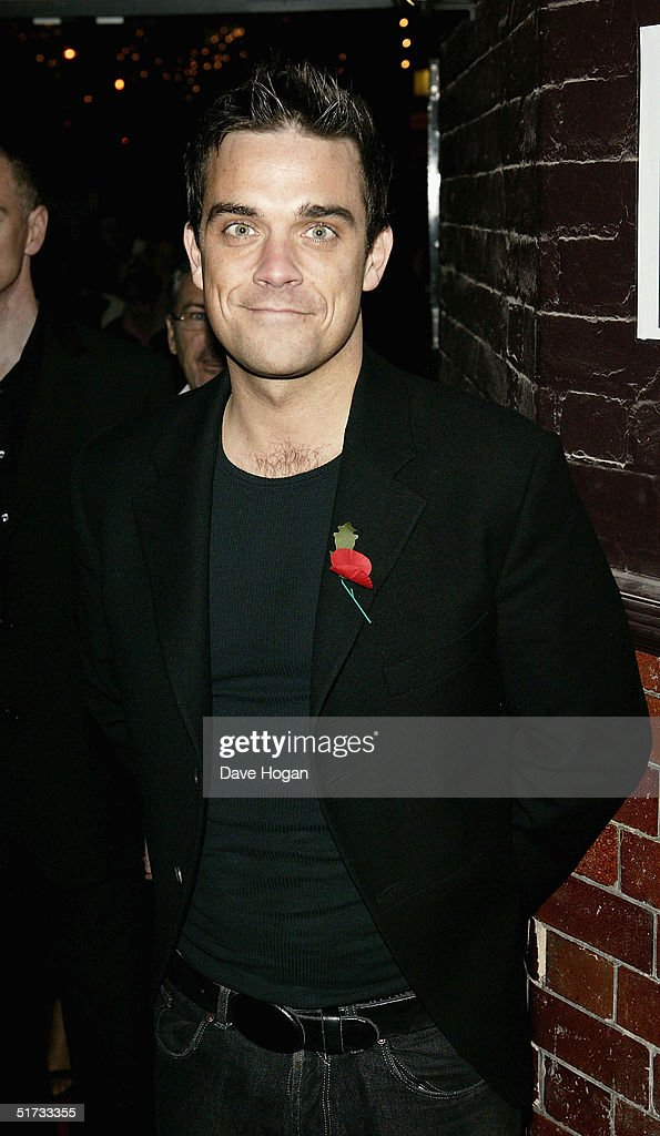 Singer Robbie Williams arrives at the final of 'UK Music Hall Of Fame', the Channel 4 series looking at popular music from the 1950's to the 1990's, at the Hackney Empire on November 11, 2004 in London. Jamie Theakston has, for the past few weeks, been asking the public to vote on who should enter Channel 4's Hall Of Fame, and the winners are inducted this evening.
