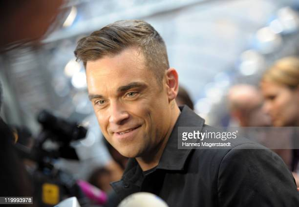 Singer Robbie Williams attends the CARS 2 Germany Premiere at the Mathaeser Filmpalast on July 28 2011 in Munich Germany