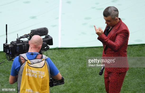 Singer Robbie Williams gestures into a TV camera during the opening ceremony prior to the 2018 FIFA World Cup Russia Group A match between Russia and...