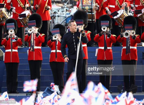 Singer Robbie Williams performs on stage during the Diamond Jubilee concert at Buckingham Palace on June 4 2012 in London England For only the second...