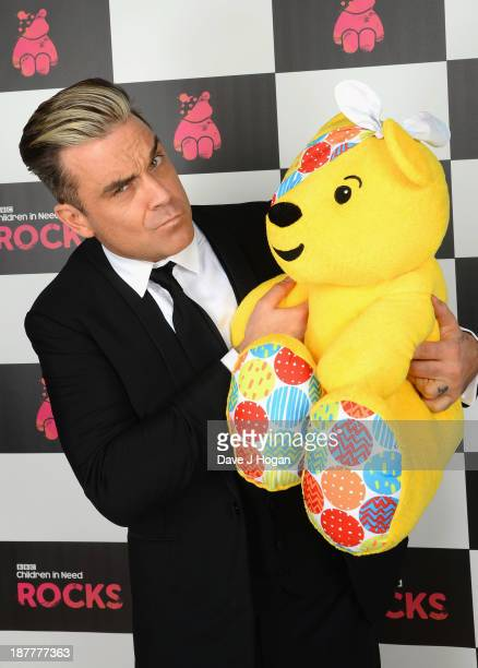Singer Robbie Williams poses backstage during the 'BBC Children In Need Rocks' at Eventim on November 12 2013 in London England BBC Children In Need...