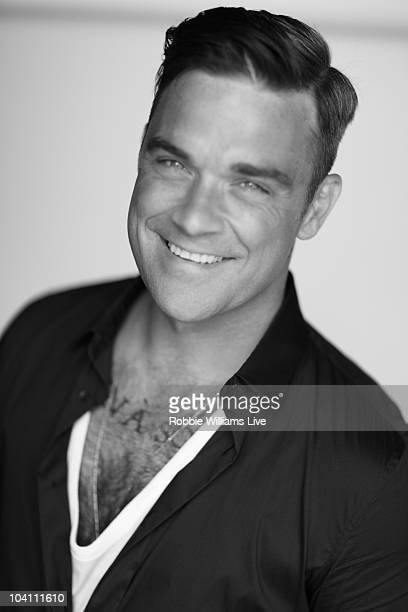 Singer Robbie Williams poses for a portrait shoot by photographer Julian Broad in Los Angeles on May 27 2010