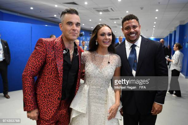 Singer Robbie Williams Russian Soprano Aida Garifullina and Ronaldo pose for a photo following their performances in the opening ceremony prior to...
