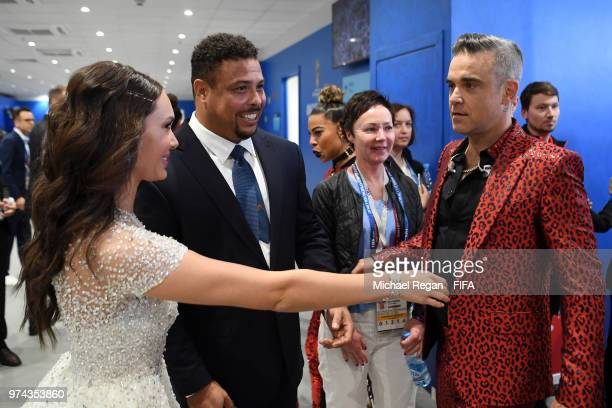 Singer Robbie Williams Russian Soprano Aida Garifullina and Ronaldo speak to each other following their performances in the opening ceremony prior to...